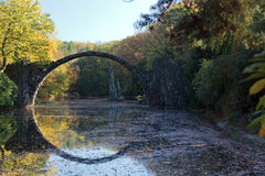 Arch Bridge in Kromlau, Saxony, Germany. Autumn in Park. Rakotz bridge in Kromlau Royalty Free Stock Images
