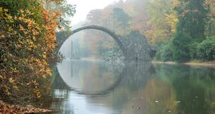 Arch Bridge in Kromlau, Saxony, Germany. Colorful autumn in Germ royalty free stock photos