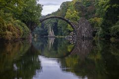 Arch Bridge in Kromlau, Saxony, Germany. Colorful autumn in Germ stock photo