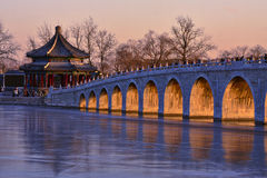 17 arch bridge and Langruting pavilion sunset. The glorious sunset on the 17 arch bridge, summer palace, Beijing Stock Image