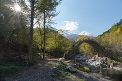 The arch bridge in mountains, Alps, Italy. Ruins of arch bridge in mountains, Rezzo municipality, Province of Imperia, Italy Royalty Free Stock Image