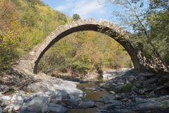 The arch bridge in mountains, Alps, Italy. Ruins of arch bridge in mountains, Rezzo municipality, Province of Imperia, Italy Stock Photography