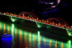 Arch bridge at night. Red arch bridge with brilliant lights at night Stock Photo