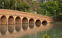 City park,public park Chatuchak Park. Arch bridge over the lake in the public park Chatuahak Park Royalty Free Stock Photography