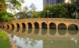 City park,public park Chatuchak Park. Arch bridge over the lake in the public park Chatuahak Park Stock Photo