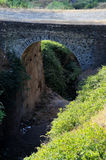 Arch Bridge over River Bed. Arched bridge over the dry river bed connect the town of Ribeira Filipe to Campana Riba on the island of Fogo, Cabo Verde Stock Image