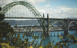 Arch Bridge Over River. Suspended cable arch bridge over a river in the Pacific Northwest Stock Photography