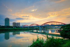 Arch bridge over the river. In Taipei by the sunset Royalty Free Stock Images