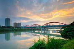 Arch bridge over the river. In Taipei by the sunset Stock Image