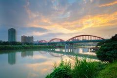 Arch bridge over the river Stock Image