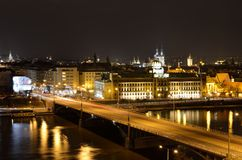 The arch bridge over river Vltava in Prague. Light traffic over the bridge highway by night in wonderful city of Prague. Construction of the bridge started in Royalty Free Stock Photography