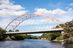 An arch bridge over Waikato river. A scenic arch bridge over Waikato river near Taupo in New Zealand Royalty Free Stock Images