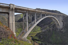 Arch Bridge on the Pacific Coast. Bridge on the Pacific Coast between Carmel and Big Sur Stock Photo