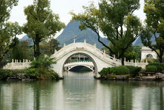 Arch bridge in park Royalty Free Stock Images
