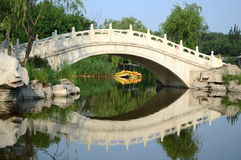 Arch bridge at park. Arch bridge reflection at park Stock Photography
