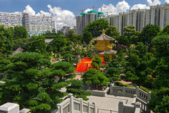 Arch Bridge and Pavilion in Nan Lian Garden, Hong Kong. Arch Bridge and Pavilion in Nan Lian Garden, Hong Kong Royalty Free Stock Image