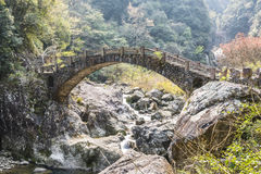 Arch bridge. This photo was taken in Longwan Lake National Forest Park, Nanxi River Scenic Area, Yongjia county,Zhejiang province,china Royalty Free Stock Photo
