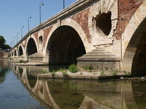 Arch Bridge Pont Neuf in Toulouse. Arches of the 16th-century bridge in Toulouse, in the South of France Stock Photography