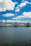 Arch bridge Preobrazhensky. Beautiful arched bridge spanning the Preobrazhensky Dnieper River in Kiev Royalty Free Stock Photo