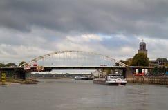Arch bridge and ship. Wilhelmina arch bridge over the river IJssel in Deventer, Netherlands Stock Photography