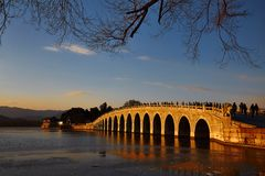 The 17-Arch Bridge in the Summer Palace. Sunset and The 17-Arch Bridge Royalty Free Stock Photos