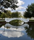 Arch Bridge. This is a Summer picture of the Schuyler Bridge located in Pana, Illinois in Christian County.  This white concrete arch Bridge over Kitchell Park Stock Photo