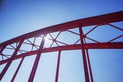 Arch bridge sunlight. Arch bridge on river e in the sunrise Stock Photography