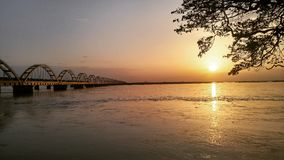 The arch bridge in the sunset. This arch bridge constructed over river godavari in the city of rajamahendravaram Royalty Free Stock Image