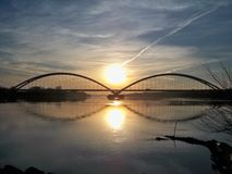 Arch bridge in sunset. Road bridge spanning the Vistula River in Torun Stock Photography