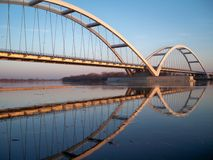 Arch bridge in sunset. Steel arch road bridge over the Vistula river in Torun Royalty Free Stock Images