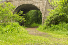 Arch Bridge Trail. A hiking trail passing through an old concrete arch railroad bridge Royalty Free Stock Photography
