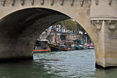 Arch bridge. View of the embankment of the river Seine through the arch of the bridge. Paris, summer day Stock Images