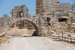 Arch and buildings. In the ancient Greek city of  Perge,  Turkey Royalty Free Stock Photos