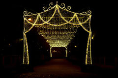 Arch with Canopy of Christmas Lights Stock Photo