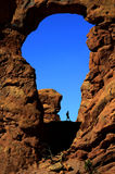 Arch in Canyon Rock Formations Silhouetter of Hiker Stock Photos