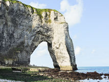 Arch cape on english channel beach of Etretat Stock Photo