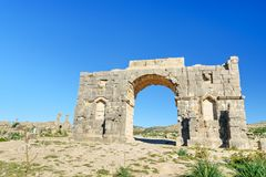 Arch of Caracalla in Roman ruins, ancient Roman city of Volubilis. Morocco. North Africa Royalty Free Stock Photo