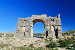Arch of Caracalla in Roman ruins, ancient Roman city of Volubilis. Morocco. North Africa Royalty Free Stock Photography