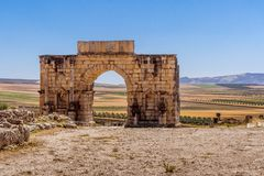 The Arch of Caracalla of Volubilis. The Arch of Caracalla, the entrance gate of Volubilis site near Fez and Meknes, Morocco. UNESCO world heritage site Royalty Free Stock Image