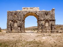 The Arch of Caracalla of Volubilis. The Arch of Caracalla, the entrance gate of Volubilis site near Fez and Meknes, Morocco. UNESCO world heritage site Stock Image