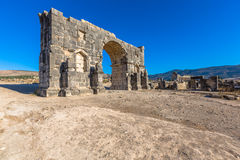 Arch of Caracalla in Volubilis, Morocco. Ancient roman triumphal arch of Caracalla at Volubilis in Morocco Stock Photography