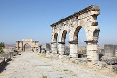 Arch of Caracalla in Volubilis. The Arch of Caracalla at Volubilis, Morocco, North Africa Stock Photo