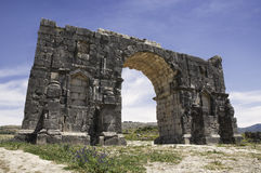 The Arch of Caracalla at Volubilis. The Arch of Caracalla in the ruin city of Volubilis in Morocco. Former Roman city Royalty Free Stock Photography
