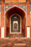 Arch with carved marble window. Humayun's tomb, Delhi. Arch with carved marble window. Mughal style.  Humayun's tomb, Delhi Stock Photo