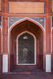 Arch with carved marble window. Mughal style. Humayun's tomb, Delhi Stock Image