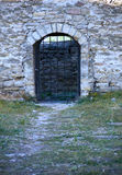 Arch castle. Big door arch with lattice  in the old castle Stock Image