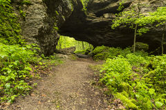 Arch Cave In Spring. A cave like arch in the woods during spring Royalty Free Stock Photos