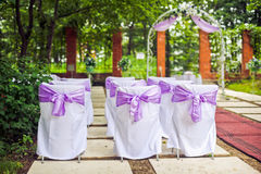 Arch and the chairs wedding ceremony. Arch and the chairs for the wedding ceremony Royalty Free Stock Photography