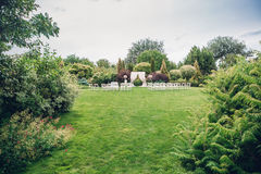 Arch and chairs for the wedding ceremony. Decorated with cloth and floral compositions Royalty Free Stock Photo
