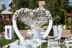 Arch and chairs at wedding ceremony. Outdoor Royalty Free Stock Photography